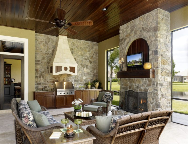 custom stone fireplace and kitchenette patio